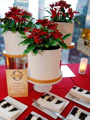 """Oprah's Poinsettia Flower Pot Cake, which looks like a holiday plant, but is actually a chocolate cake with vanilla mousse, is displayed at the headquarters of """"O-The Oprah Magazine,"""" Tuesday, Nov. 1, 2016, in New York during a sneak peak of Oprah's Favorite Things, the popular television personality's 2016 Christmas and holiday gift choices."""