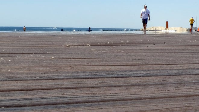 Towns at the Jersey Shore lost thousands of residents during the first part of the decade, U.S. Census Bureau data showed. People walk on the Belmar boardwalk in this 2013 file photo.