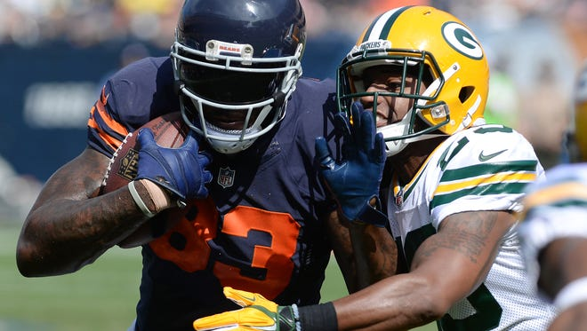 Green Bay Packers cornerback Casey Hayward (29) tries to tackle Martellus Bennett (83) against the Chicago Bears at Soldier Field September 28, 2014.  Jim Matthews/Press-Gazette Media/@jmatthe79