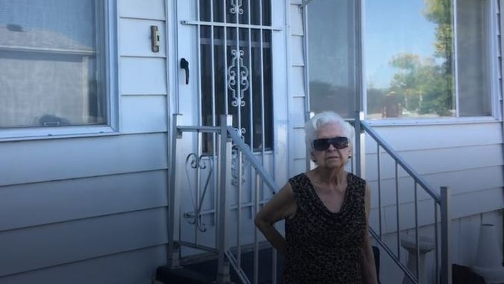Dorothy Funk outside her manufactured home at Western