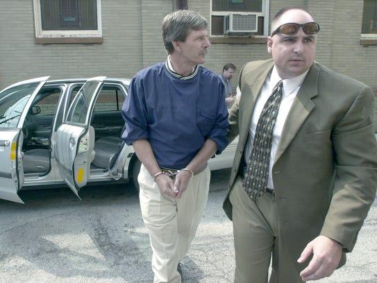 Gregory Harry Neff, 53, is brought in the back door