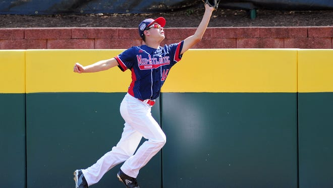M-E outfielder James Fellows catches a fly ball in the second inning against the Asia-Pacific Region during the championship game of the 2016 Little League World Series at Howard J. Lamade Stadium.