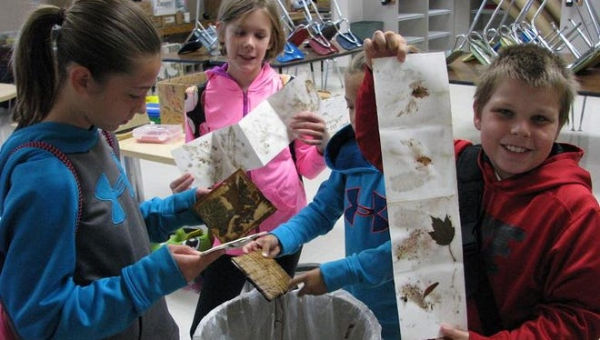 Auburndale Elementary fourth-grade art students are exploring ways to combine art and nature. One method involved soaking and steaming fresh plant, leaf, and flower material to make naturally colored leaf prints.