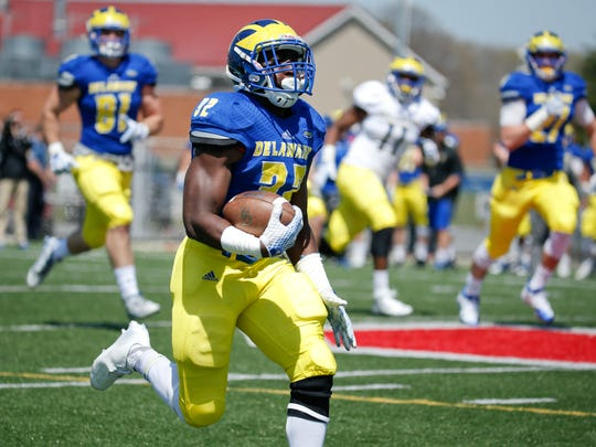 Delaware running back Kareem Williams gets through the line in game situation scrimmaging during a spring practice at Smyrna High School Saturday.