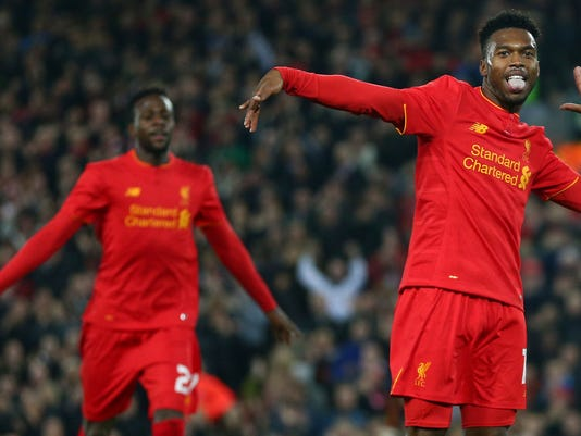 FILE =- A Tuesday, Oct. 25, 2016 file photo of Liverpool's Daniel Sturridge, right, celebrating scoring the second goal of the game during the English League Cup soccer match between Liverpool and Tottenham Hotspur at Anfield in Liverpool, England. Liverpool has sent Daniel Sturridge on loan to fellow English Premier League team West Bromwich Albion after the striker dropped out of favor at Anfield. West Brom, which is next to last in the standings, said on Monday, Jan. 29, 2018 that Sturridge has joined until the end of the season. (AP Photo/Dave Thompson, File)