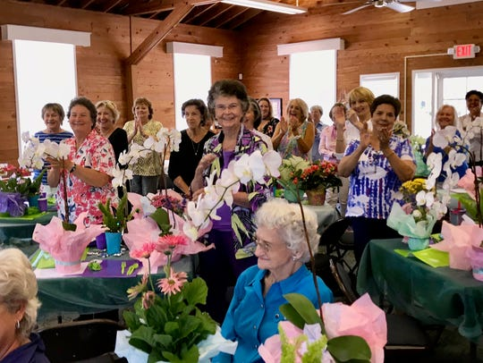 The members of Garden Club of Fort Pierce saluted and