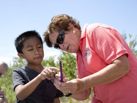 Alex Ruiz-Garcia, 8, learns how to read an underwater