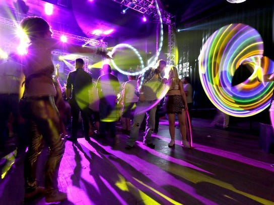 Dannii Devine (left) hula hoops during a Daisyland event at the New Daisy Theatre.