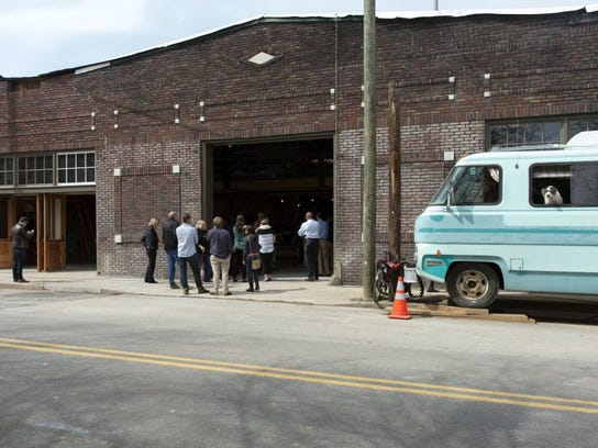 Guests gather outside of the Mill & Mine during a news conference announcing the details of the new concert and event space at 225 W. Depot Ave. in March 2016.