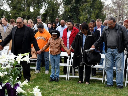 Clergy and worshippers hold hands during services at the fourth annual community Easter sunrise service at the Knoxville Botanical Garden and Arboretum. (J. Miles Cary/Special to the News Sentinel)