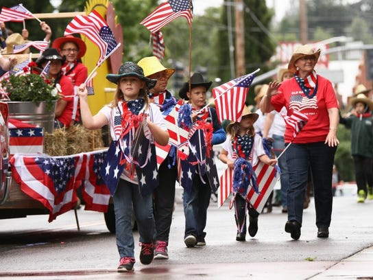 Children from Exodus Farms march down the Redding Rodeo