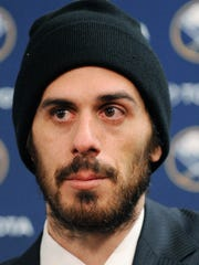 Ryan Miller listens to a question from reporters in Buffalo after he was traded to the St. Louis Blues on Friday.