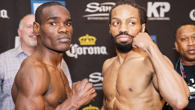 Edner Cherry, left, and Omar Douglas after their weigh-in Monday.