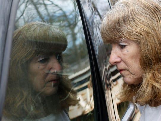 Deborah Franklin looks through the window of her son