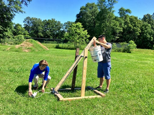 Krey Gagnard and D.J. Gagnard prepare their trebuchet for launch Wednesday..