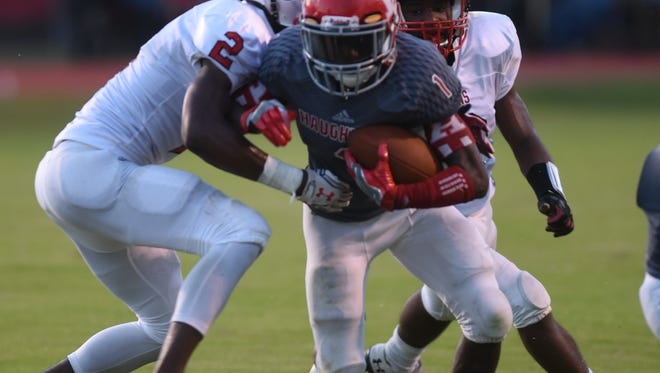 Haughton's Jadon Morrison breaks through the Plain Dealing defensive line for yardage.