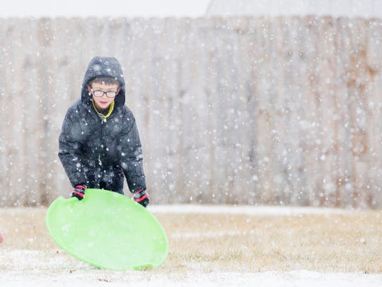 Joshua Chiffon, 9, readies himself for another sled