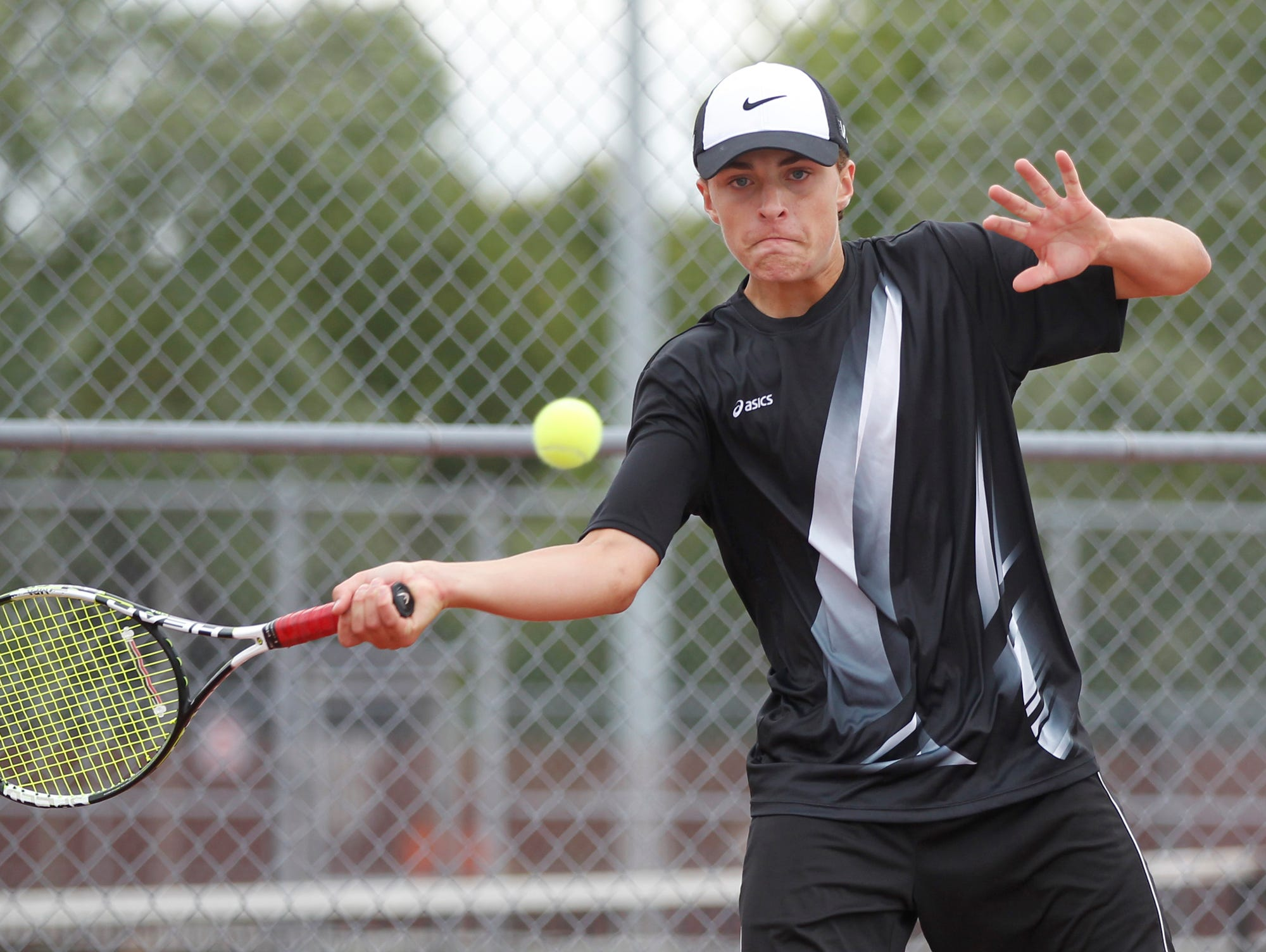 Lafayette Jeff's TJ Preston with a return against West Lafayette's Eric Malone in No. 3 singles during the boys tennis sectional championship Friday, October 2, 2015, at Cumberland Courts in West Lafayette.