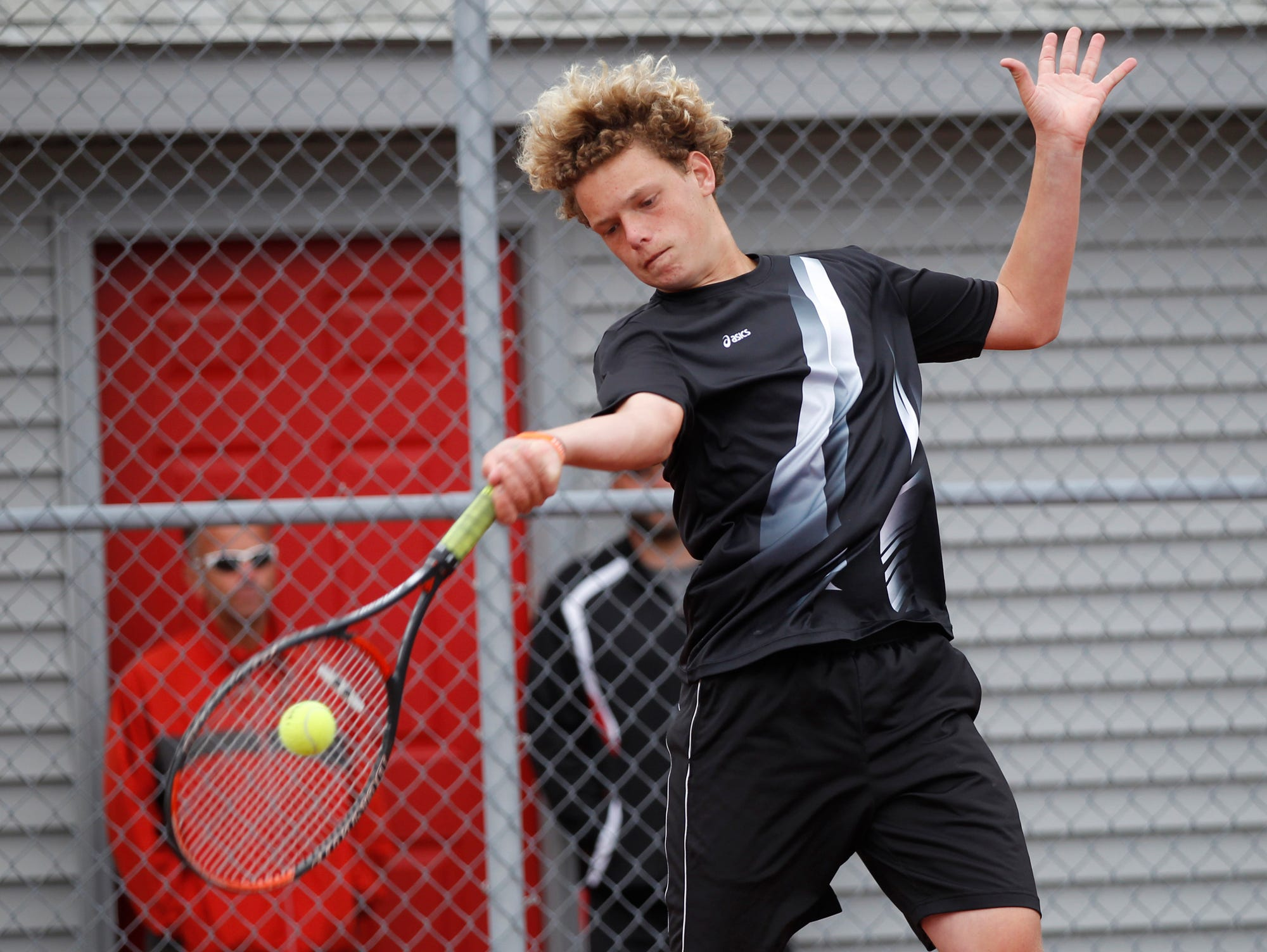 Lafayette Jeff's Aden Beaver with a return as he and Brayden Williams face West Lafaytte's Brian Mi and Jethro Zhou at No. 1 doubles during the boys tennis sectional championship Friday, October 2, 2015, at Cumberland Courts in West Lafayette.