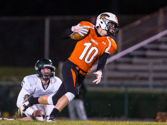 Palmyra's Braden Vernet finds room after shedding Trinity's Sean Scott for one of his four catches on Friday night.