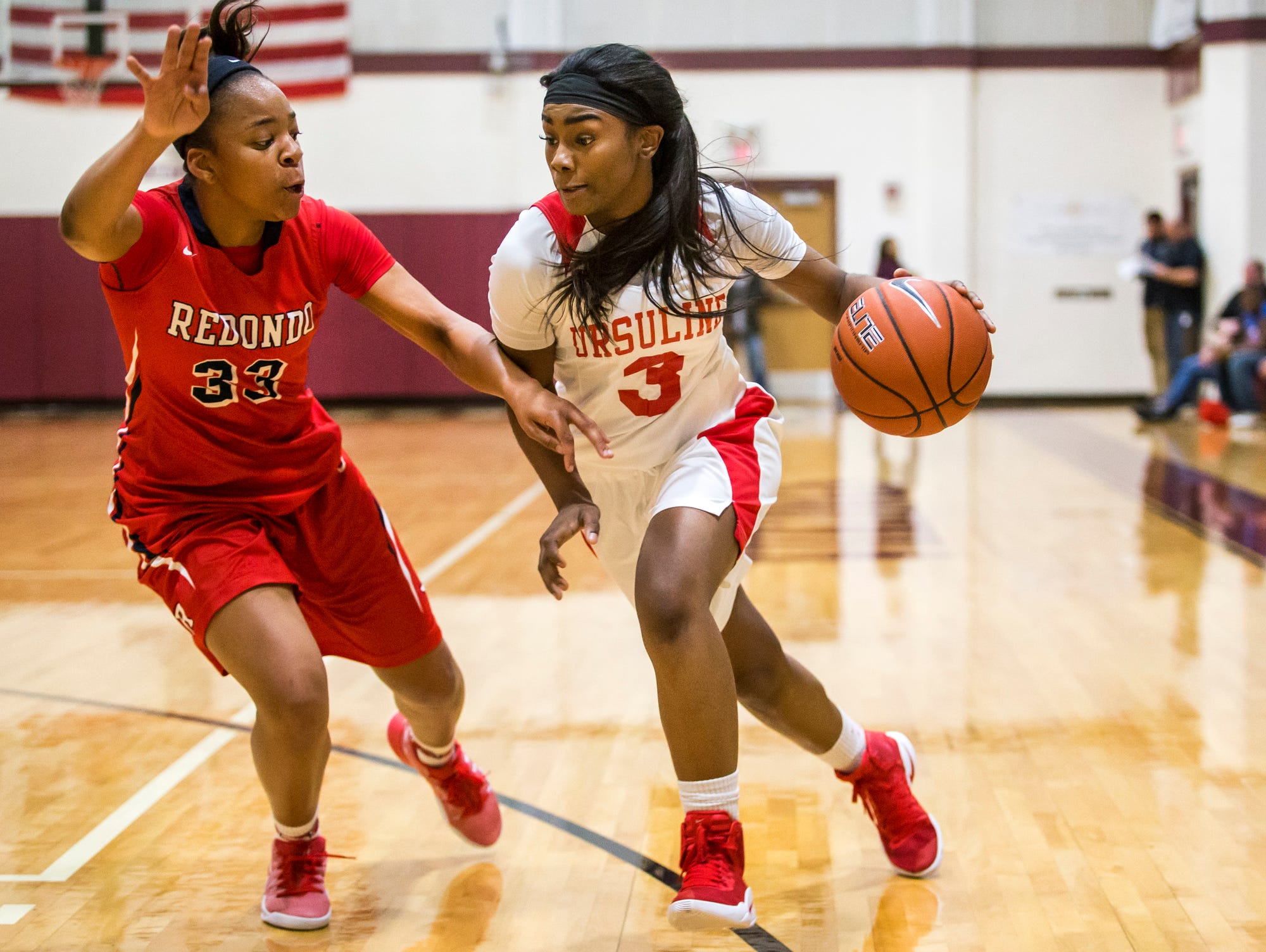 Ursuline's Yanni Hendley-Mccalla drives to the basket against Redondo Union's Nicole Swift in the first half of Ursuline's 39-26 win over Redondo Union High School in the Diamond State Classic at St. Elizabeth High School in Wilmington on Tuesday night.