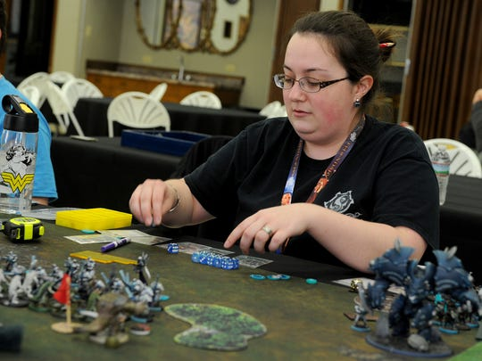 Brionne Perry plays in the Warmachine/Hordes tournament