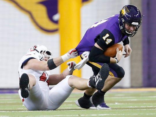 South Dakota's Darin Greenfield tackles Northern Iowa quarterback Eli Dunne.