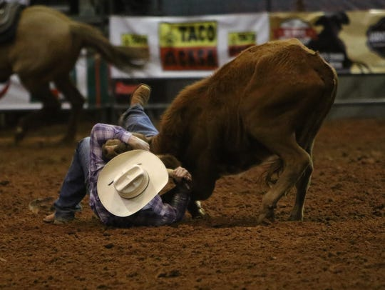 Jarret New competes in steer wrestling during the second