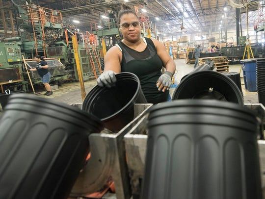 Sophia Montina works on a flower pot assembly line