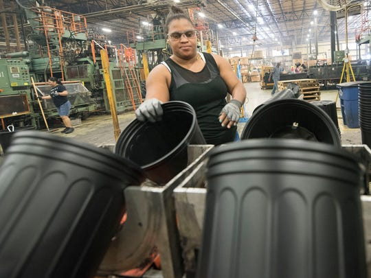 Sophia Montina works on a flower pot assembly line Thursday, June 28, 2018 at Nursury Supplies. Nursery Supplies, Orchard Drive, Chambersburg, produces flower pots of different sizes and is a major plastics recycling operation.