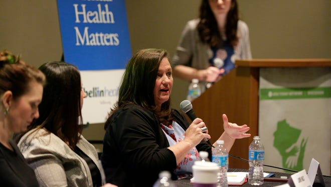 Elizabeth Hudson, director of the state Office of Children's Mental Health, speaks at Lawrence University March 10. Hudson said she is working to better understand costs and results of county mental health services.