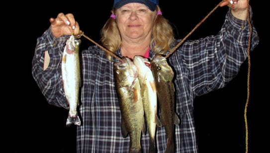 My wife Carol caught a rainbow trout and several largemouth