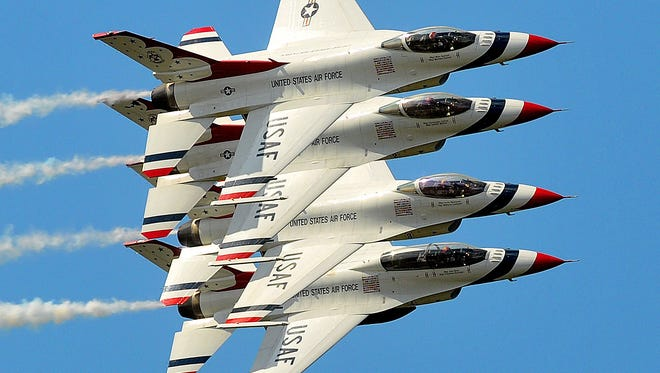 The U.S. Air Force Thunderbirds perform during the 2015 TICO Warbird Airshow in Titusville.