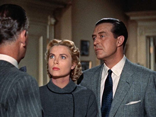 From left John Williams, Grace Kelly and Ray Milland