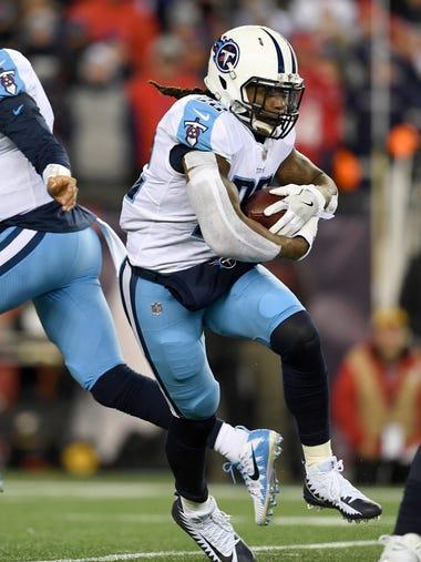 Titans running back Derrick Henry (22) gains yards