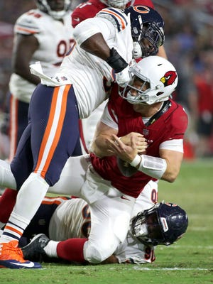 Arizona Cardinals quarterback Drew Stanton (5) is sacked by Chicago Bears defensive end Jonathan Bullard, right, and Chicago Bears outside linebacker Sam Acho, left, during the first half of a preseason NFL football game, Saturday, Aug. 19, 2017, in Glendale, Ariz. (AP Photo/Ralph Freso)