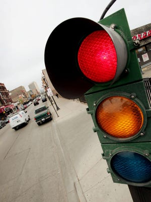 In this 2005 file photo a traffic light controls the flow of vehicles and pedestrians near downtown Chicago, Illinois.