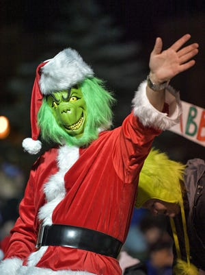"The Oshkosh Chamber of Commerce 2016 Holiday Parade kicked off the season in Oshkosh Thursday evening, November 17, 2016. Hundreds of people lined Main Street for floats highlighting the theme ""Whoville."""