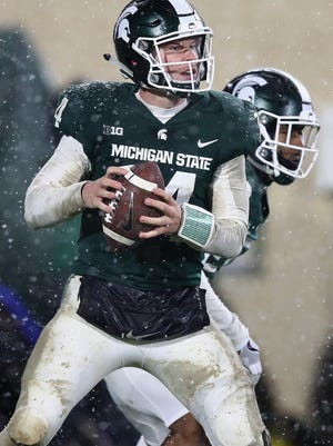 Brian Lewerke completed just 2 of 14 passes for 20 yards in poor weather conditions last week against Maryland.