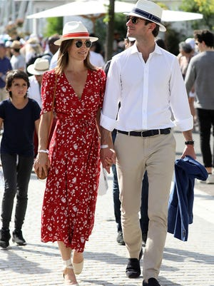 A coordinating couple! Pippa Middleton and husband James Matthews held hands and matched hats on Saturday at the French Open