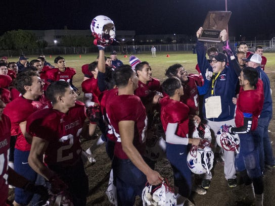 Strathmore Head Football Coach Jeromy Blackwell raises