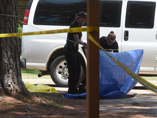 Law enforcement works the scene of a shooting in the