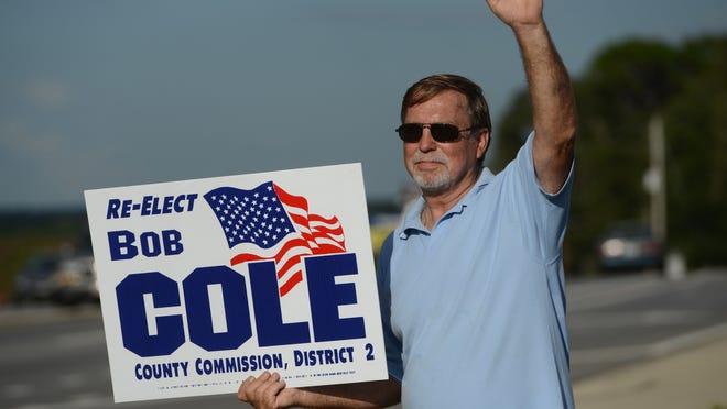 Santa Rosa County Commissioner Bob Cole stumps along Avalon Boulevard in Milton on Tuesday night.