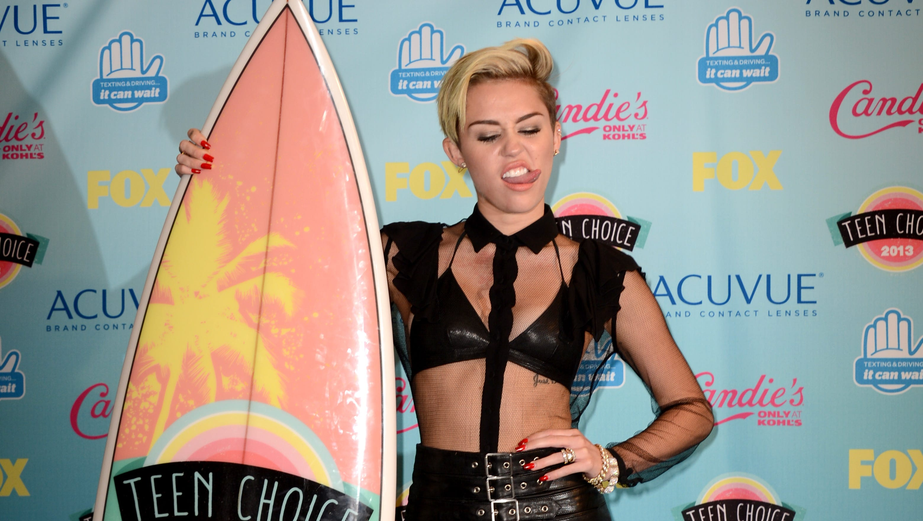 """Miley Cyrus, takes home an award for Choice TV Female Scene Stealer for """"Two and a Half Men."""""""