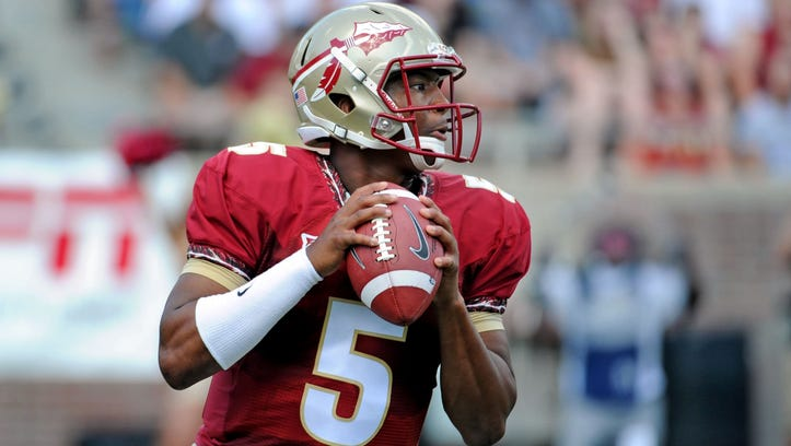 Apr 12, 2014; Tallahassee, FL, USA; Florida State Seminoles quarterback Jameis Winston (5) looks to throw the ball during the spring game at Doak Campbell Stadium. Mandatory Credit: Melina Vastola-USA TODAY Sports