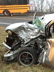 A vehicle driven by Jess Hoffer, 22, Palmrya, sits