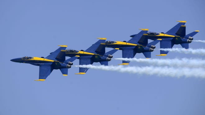 The Blue Angels fly over the crowd at Pensacola Beach on Saturday during the Blue Angels Pensacola Beach air show.