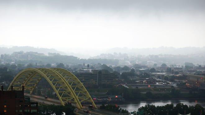 Thunderstorms move over the Daniel Carter Beard Bridge Wednesday morning.