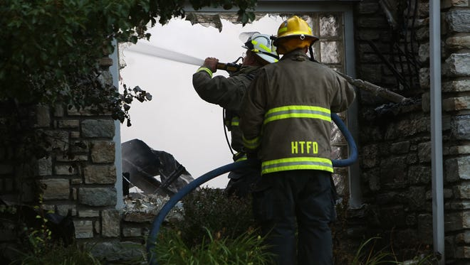 Fire crews put out hot spots from a fire on Gardner in Hanover Township Tuesday morning.