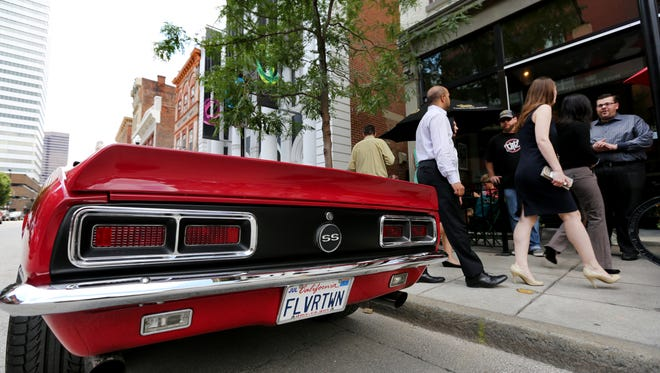 Guy Fieri's red Camaro parked in front of Taste of Belgium in Over-the-Rhine while he  was filming 'Diners, Drive-ins and Dives' on July 9.